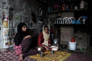 """Naseema Akhtar, 30 and her daughter Shazia Anwar, 13 at their one-room house in the old city of Srinagar await the call to break fast. Naseema's husband, Syed Anwar, is among some 8,000 people who have disappeared in the restive region"" (via Al Jazeera)"